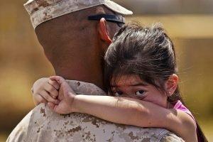 Military Man and a Child - VeteranCarDonations.org