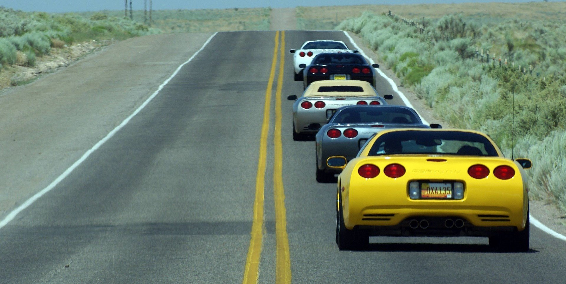 Corvettes Lining Up on a Highway in New Mexico - VeteranCarDonations.org