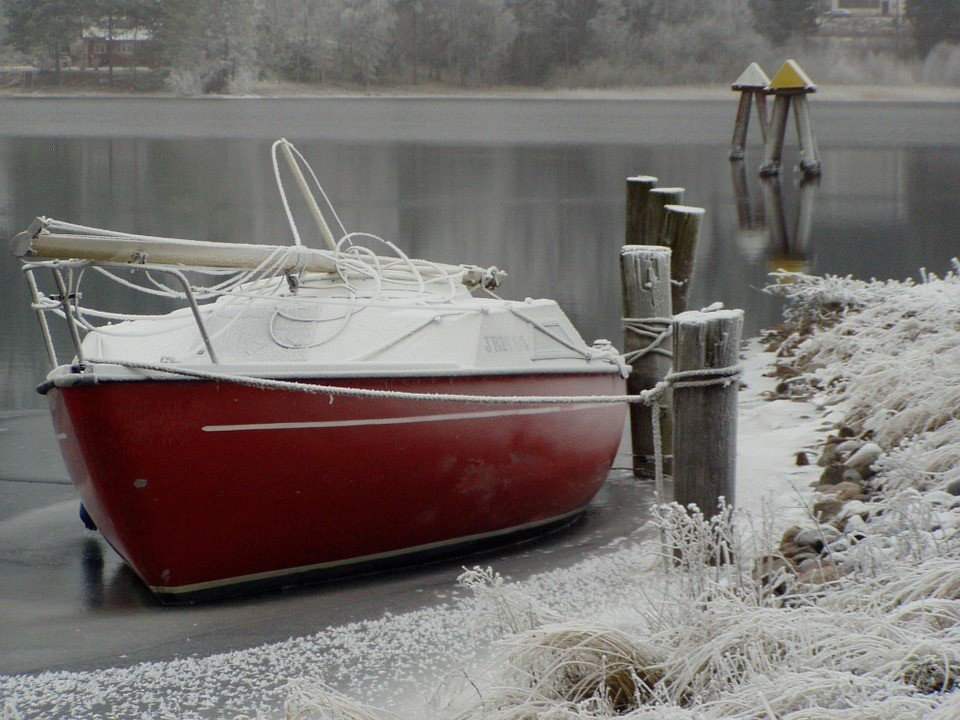 Boat Sitting on an Icy Cold Waters - VeteranCarDonations.org