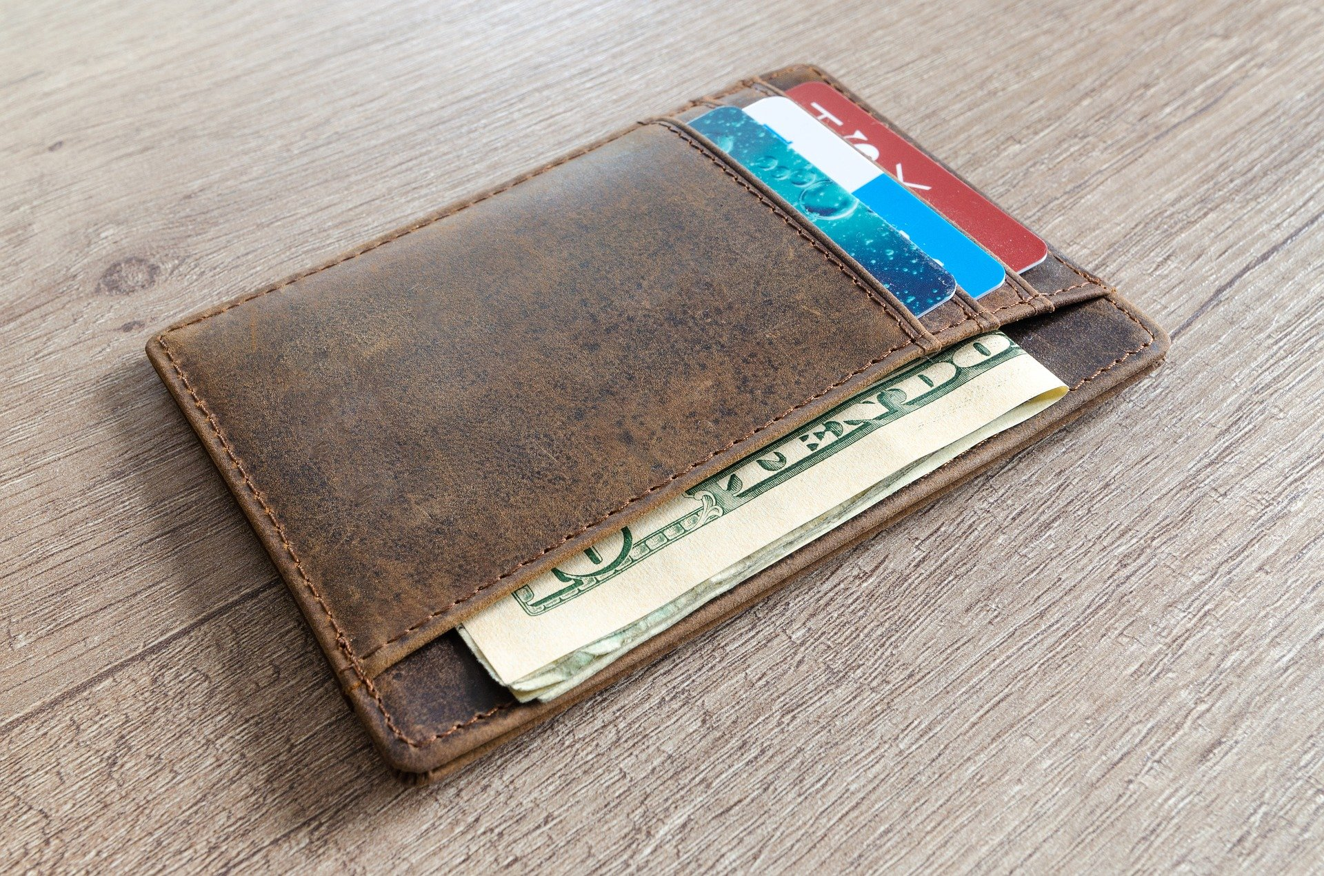 Cash and Card in a Wallet - VeteranCarDonations.org