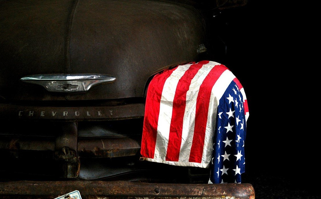 American Flag on a Old Car | Veteran Car Donations