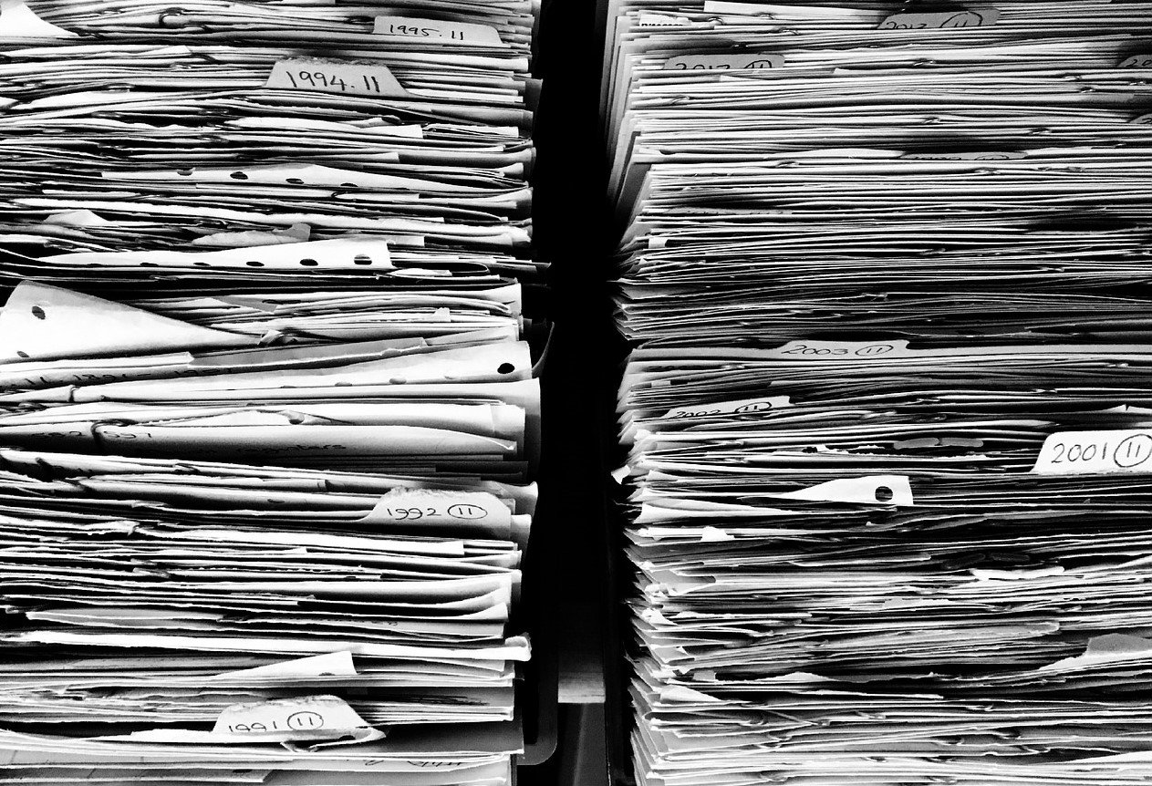 Pile of Document Files | Veteran Car Donations