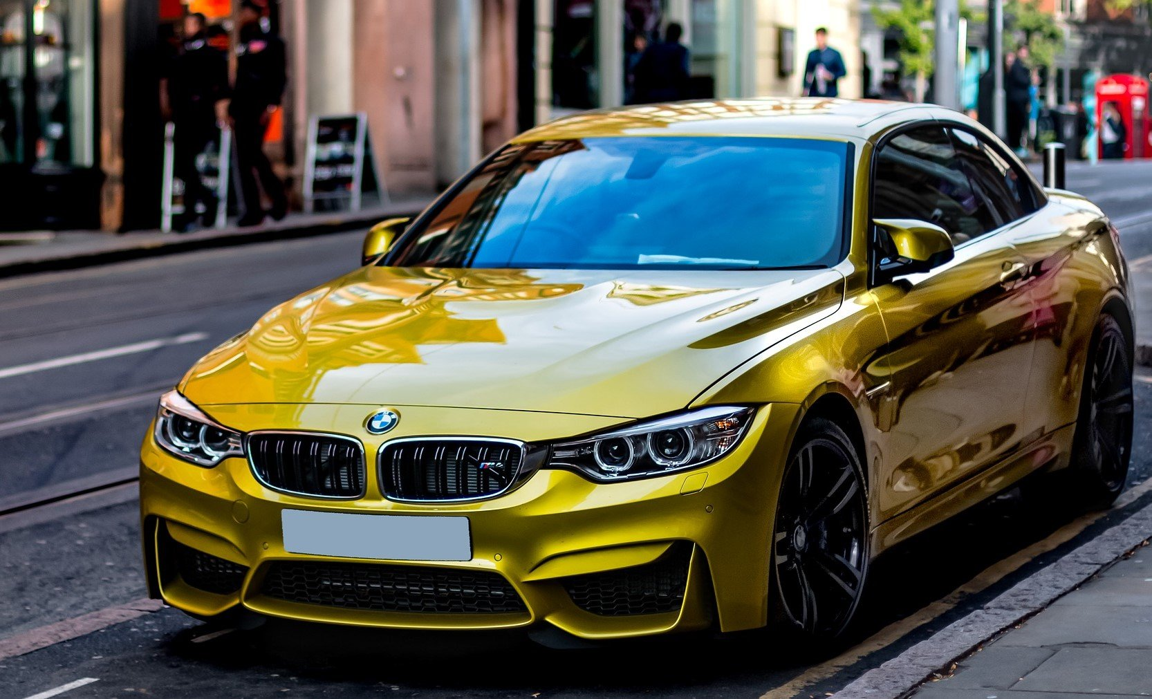 Yellow BMW on a Street | Veteran Car Donations