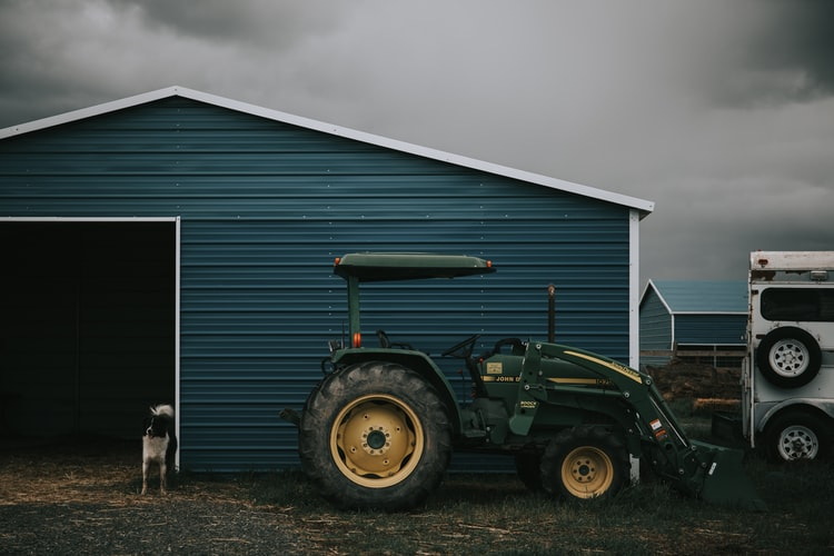 Parked Green Tractor | Veteran Car Donations